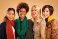 Four women smiling group of wearing warm clothes Royalty Free Stock Photography