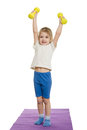 Four-year-girl lifted dumbbells over a Royalty Free Stock Photo