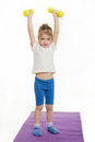 Four-year-girl lifted weights up Royalty Free Stock Photo