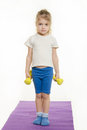 Four-year girl is preparing to raise two dumbbells Royalty Free Stock Photo
