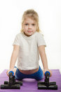 Four-year girl pressed the palm pushups Royalty Free Stock Photo