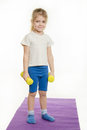 Four-year girl standing with dumbbells Royalty Free Stock Photo