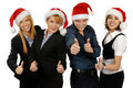 Four young businesspersons in Christmas hats Royalty Free Stock Image
