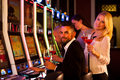 Four Young People Playing Slot...