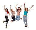 Four young woman jumping for joy Royalty Free Stock Photos