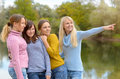 Four young woman relaxing together in nature