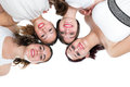 Foursome girlfriends joining heads beauty portrait of teen isolated on white background Stock Photos