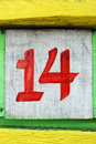 Fourteen number painted on an old painted wood board Stock Images