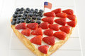 Fourth of july cake heart shaped independance with fresh berries Stock Images