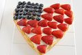 Fourth of july cake heart shaped independance with fresh berries Stock Image