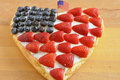 Fourth of july cake heart shaped independance with fresh berries Stock Photo