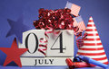 Fourth of july celebration save the date white block calendar with stars and stripes flags and party decorations in usa america Royalty Free Stock Photos