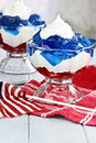Fourth of july dessert gelatin layered cubes red and blue jello with white flufy whipped cream for the holiday shallow depth Royalty Free Stock Photography