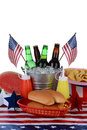 Fourth of july picnic table closeup a decorated for the vertical format with a white background items include a bucket full Stock Photography