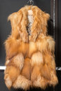 Fox fur vest on a hanger in the store Royalty Free Stock Photography