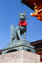 Fox holding a key in its mouth at the main gate of the fushimi inari shrine kyoto japan Royalty Free Stock Images