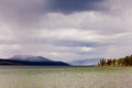 Fox lake rain shower yukon territory canada showers over and distant mountain range Stock Photos