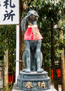 Fox statue at the fushimi inari shrine kyoto japan Stock Photo