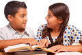 Frère et soeur hispaniques mignons having fun studying Image stock