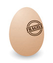 Fragile egg conceptual illustration of a cracked with stamp Stock Photos