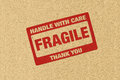 Fragile logo on brown paper Royalty Free Stock Photos