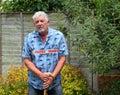 Weak, fragile senior man standing with cane. Royalty Free Stock Photo
