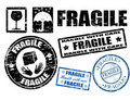 Fragile signs and stamps Royalty Free Stock Photo