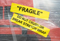 Fragile warning sign sticker with plastic wrap Royalty Free Stock Photography