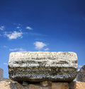 Fragment of ancient ruins with lettering Royalty Free Stock Photo