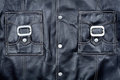 Fragment of black leather jacket Stock Images