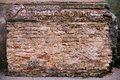 Fragment of brick pilaster with plaster crumbling Stock Photos