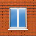 Fragment of brick wall with plastic window Royalty Free Stock Photography
