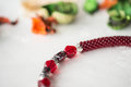 Fragment of choker necklace made from beads and beaded rope Royalty Free Stock Photo