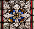Fragment of colored ornamental glass of window of the church Royalty Free Stock Photo