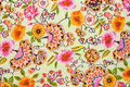 Fragment of colorful retro tapestry textile pattern with floral handmade ornament and flowers as background Royalty Free Stock Images