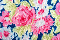 Fragment of colorful retro tapestry textile pattern with handmad handmade floral ornament and flowers as background Stock Photography