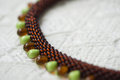 Fragment of a hand made necklace from two types of beads close up Royalty Free Stock Images