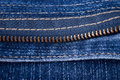 Fragment of a jeans fastener Stock Image