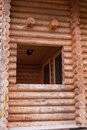 Fragment of log house window rectangular without glass cabin wall Stock Photos