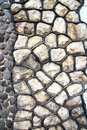 Fragment of an modern handmade stone wall as backgrounds Royalty Free Stock Photo