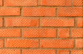 Fragment of a new wall made red brick with striations Stock Photography