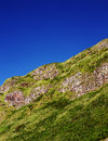 Fragment of a northern irish cliffs overgrown with grass Royalty Free Stock Photo