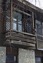 Fragment of old building with wooden balcony and bird house koprivshtitsa town bulgaria Royalty Free Stock Photography