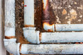 A fragment of the old  conduit and Joint pipes corrode. Royalty Free Stock Photo