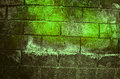 Fragment of old dirty brick wall with peeling plaster texture white grey brown black green blue lime yellow orange maroon violet p Royalty Free Stock Photo