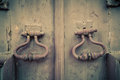 Fragment of old wooden door with metal knob Royalty Free Stock Photo