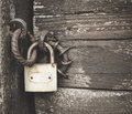 Old padlock on a wooden door Royalty Free Stock Photo