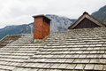 A fragment of old wooden roof of a house in the Alps Royalty Free Stock Photo