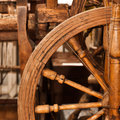 Fragment of old wooden spinning wheel closeup Royalty Free Stock Photography
