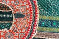 Fragment of patchwork background on retro Indian handmade carpet. Colorful handmade vintage blanket. Royalty Free Stock Photo